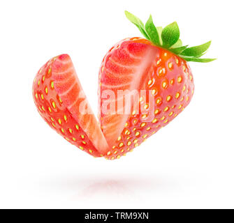 Isolated berry. One strawberry fruit with cut out piece in the air isolated on white background with clipping path - Stock Image