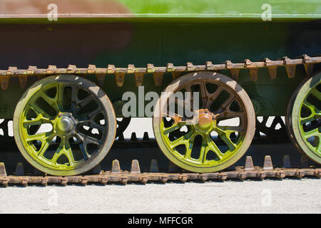 Part of a continuous track on a military amphibious vehicle. The vehicle has a verdant camouflage scheme on it. - Stock Image