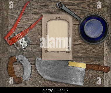 vintage kitchen knife and utensils over wooden board board, blank card for your text - Stock Image