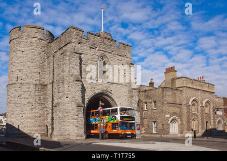 Westgate Towers,Medieval Gateway,Double Decker,Bus,Squeezing Through,Canterbury,Kent,England,Kent Former Canterbury Police Station,On Right - Stock Image