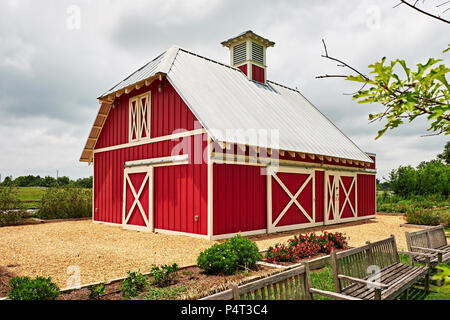 Small red barn found on a rural farm or ranch mainly used for storage in the United States. - Stock Image