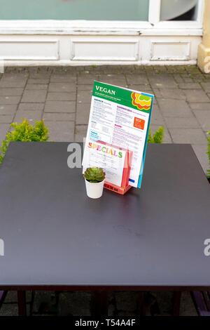 Vegan menu on table - Stock Image
