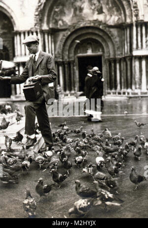 Photographer and Pigeons, 1923 - Stock Image