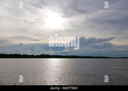 Cumulo Nimbus rain clouds form over the Zambezi River, Zambia, at sunset - Stock Image