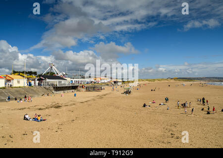 Coney Beach in Porthcawl at low tide. It is a traditional seaside resort on the South Wales coast - Stock Image