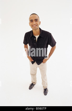 Young Indian man in studio - Stock Image