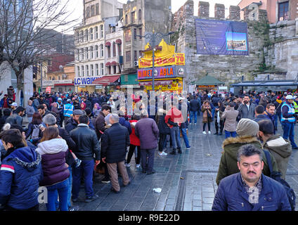 Istanbul, Turkey.  Thousands wait in line to buy ticket for the Turkish national lottery's New Year's eve draw some waiting over 3 hours from the Nimet Abla in Eminonu Square, an annual tradition due to believed lucky nature of the establishment. - Stock Image