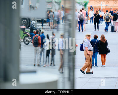 People commuting and walking near Atocha train station in Madrid - Stock Image