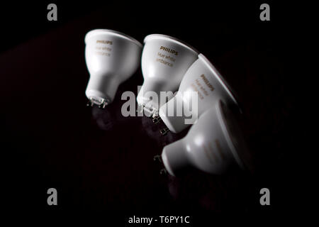 Philips Hue White Ambiance GU10 light bulbs pictured in London. May 1, 2019. The LED bulbs are modern smartphone voice activated technology. - Stock Image