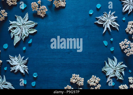 White Sage and Native Flowers with Blue Glass, arranged with Space for Copy - Stock Image