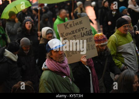 Vienna, Austria. 13th Jan, 2018. protester holding a sign during an anti-government demonstration. the sign reads - Stock Image