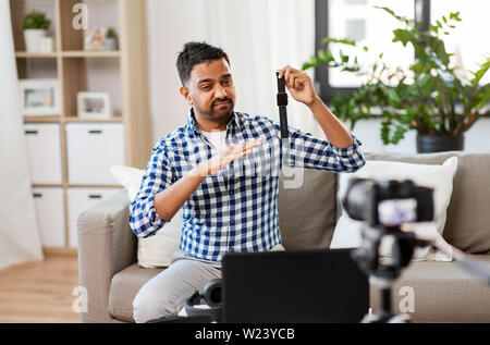 male blogger with smart watch recording video blog - Stock Image