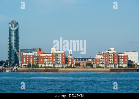 General view on a warm summers evening with a blue sky across Portsmouth Harbour to Gunwharf Quays Marina Old Portsmouth - Stock Image