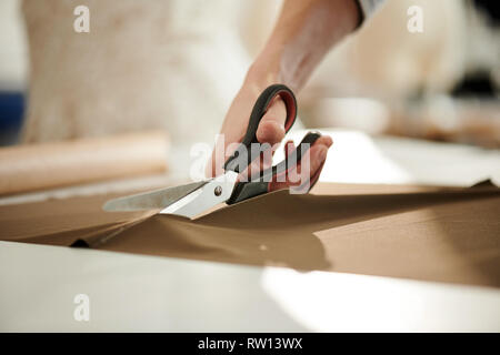 Cutting fabric - Stock Image