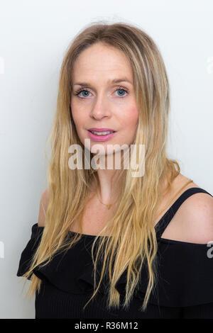 Blond Irish woman with long hair, evening dress - Stock Image