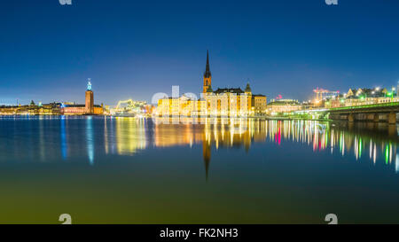 View of Stockholm City Hall, left, and Riddarholmen island, and church, centre, seen from Södermalm, Stockholm, - Stock Image