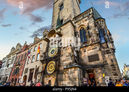 Tourists visit the medieval Astronomical Clock in Old Town Square in Prague, Czech Republic - Stock Image