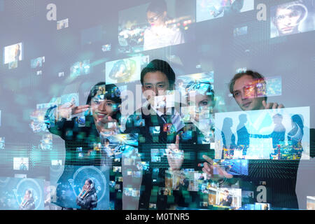 Group of people watching holographic visions. - Stock Image