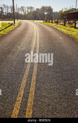 A country road, sometimes called a 'two-lane blacktop' near Lititz, Lancaster County, Pennsylvania, USA - Stock Image