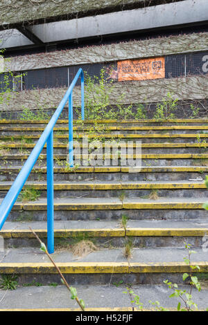 Overgrown derelict steps at the entrance to the former police Headquarters building on Irwell Street,  Bury, Lancashire. - Stock Image