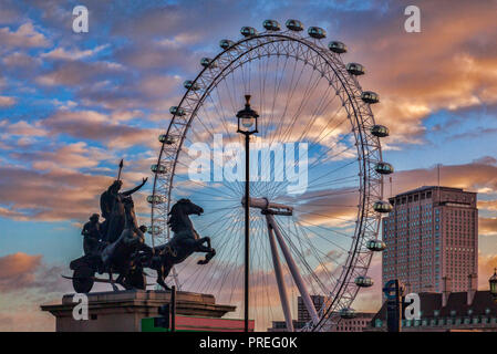 Statue of Boudica, Queen of the Iceni, and the London Eye. - Stock Image
