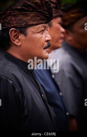 Man attending a Bali Royal Cremation Ceremony, Ubud - Stock Image