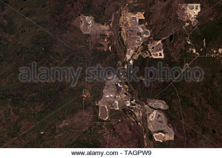 Athabasca oil sands mining operations near Fort McMurray in Alberta, Canada seen from space - contains modified Copernicus Sentinel Data (2019) - Stock Image