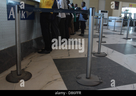 Passengers queue behind retractable belt posts at the domestic wing of the Murtala Muhammed Airport, Ikeja-Lagos. - Stock Image