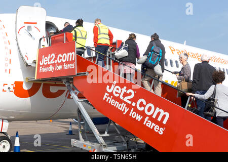Passengers board a Jet 2 Boeing 737 aircraft on the runway at East Midlands Airport in Leicestershire, UK. 15 April 2019. - Stock Image