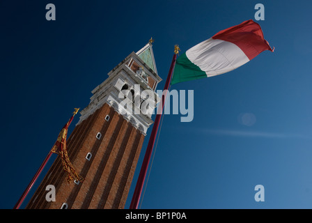 Italian flag and Campanile, St Mark's Square, Venice, Italy - Stock Image