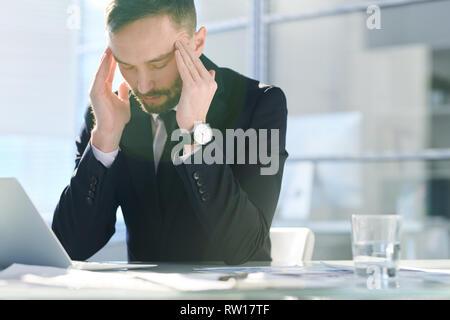 Having headache - Stock Image