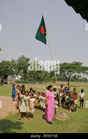 BANGLADESH Assembly at a school attended by the Garo tribal minority outside their building, Haluaghat, Mymensingh region photo by Sean Sprague - Stock Image