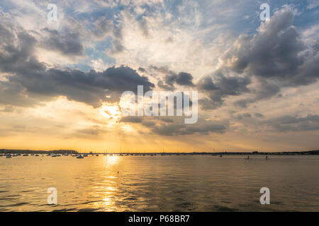 Poole, UK. 28th June 2018. UK weather. The sun sets over Poole Harbour on one of the hottest days on record. Credit Thomas Faull / Alamy Live News - Stock Image