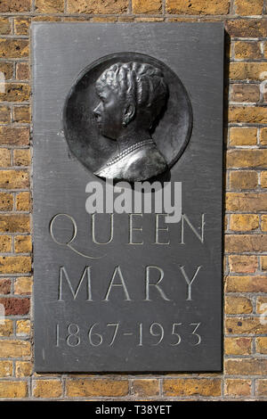 A brass plaque in memory of Queen Mary in Central London at Marlborough House - Stock Image