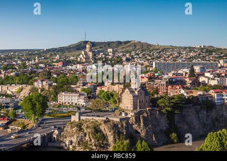 Georgia, Tbilisi, Tsminda Sameba Cathedral and Metekhi Church - Stock Image