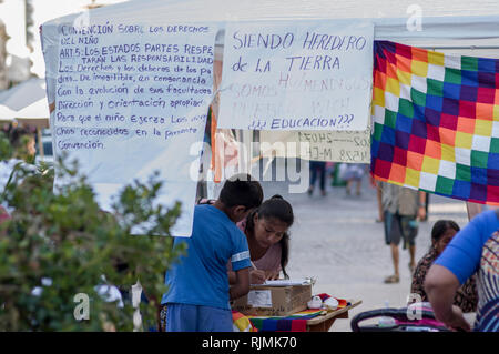 Wichis people in the main square in Salta, Argentina protesting for indigenous people's rights to education in the Wichi language - Stock Image