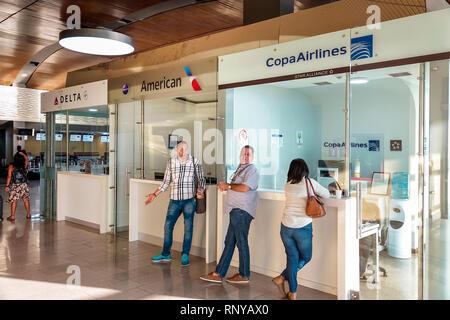 Cartagena Colombia Aeropuerto Internacional Rafael Nunez Airport inside concourse terminal Hispanic man woman Copa Airlines ticket desk - Stock Image