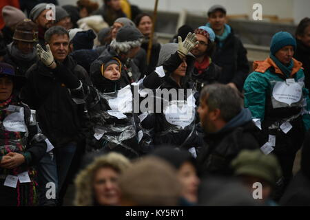 Vienna, Austria. 13th Jan, 2018. female protester performing during an anti-goverment demonstration. Credit: Vincent - Stock Image