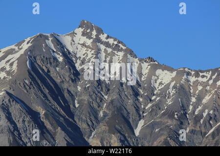 Peak of the Lenzer Horn, view from Obermutten, Switzerland. - Stock Image