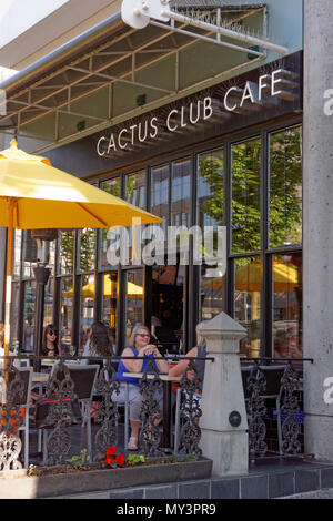 People sitting on the outdoor patio at the Cactus Club Cafe on West Broadway, Vancouver, BC, Canada - Stock Image
