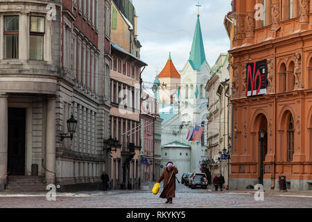 Winter day in Riga old town with Our Lady of Sorrow church in the distance. - Stock Image