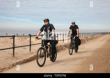 Crosby, Merseyside. 20th March, 2019. Warm hazy spring day as  community-based. PCSO's patrol at the coast on the seafront promenade. Credit: MWI/AlamyLiveNews - Stock Image