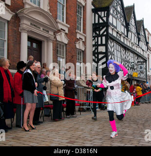 Andrea Mulchrome winning the Womens Pancake Race which is part of the traditional Shrovetide Fair in Bore Street - Stock Image