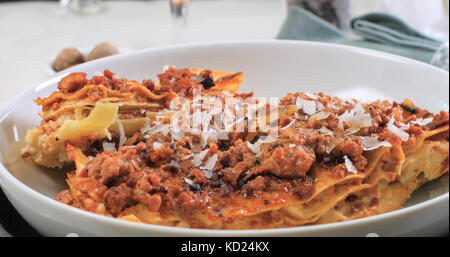 Close up view of delicious steamy lasagne in bolognese sauce - Stock Image