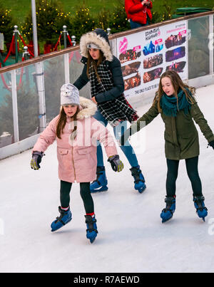 Edinburgh, Scotland, United Kingdom,  8th November 2018. Christmas celebrations: A busy Saturday in the capital city centre at Edinburghs Christmas celebration venue. Families enjoy the ice skating rink in St Andrew Square Gardens. Girls enjoying skating - Stock Image