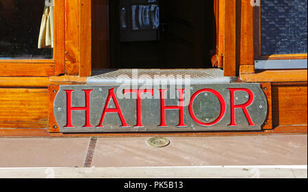 A view of the nameplate of the Norfolk Pleasure Wherry Hathor moored on the River Ant by How Hill, Norfolk, England, United Kingdom, Europe. - Stock Image
