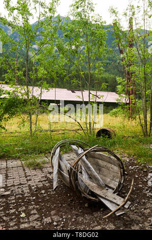 Crushed antique wood barrel at the abandoned Canfranc International railway station (Canfranc, Pyrenees, Jacetania, Huesca, Aragon, Spain) - Stock Image
