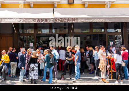 Locals outside the Casa Vizcanino bar on Calle Feria in Seville - Stock Image