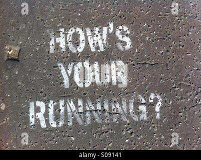 How's your running. Spray painted on Tarmac - Stock Image