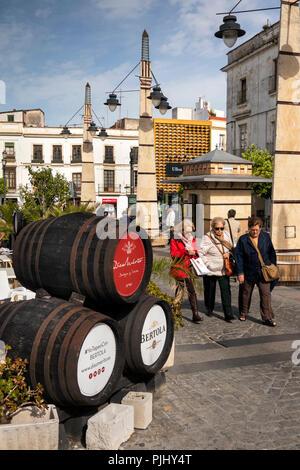 Spain, Jerez de La Frontera, Plaza de Abastos, sherry barrels decorating pavement cafe - Stock Image